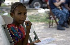 Young girl coloring. Haiti