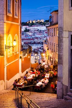 beautiful street scene at night with lovely buildings and an outdoor restaurant terrace. sigh. Lisbon, Portugal