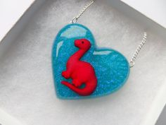Baby Dinosaur Resin Heart Shaped Necklace Glittery by CandyShockUK Heart Shaped Necklace, Baby Dinosaurs, Kawaii Jewelry, Blue Glitter, Kitsch, Heart Shapes, Jewelry Collection, Resin, Handmade Jewelry