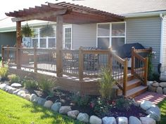 Back deck idea's... we would have stairs facing the fire pit and stairs facing the shop. I like the trellis!