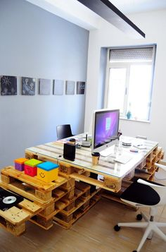Lots of upcycled pallets create this desk and workspace in a quirky office. More pallet patio, gardening, DIY furniture ideas and inspiration at http://pinterest.com/wineinajug/passion-for-pallets/