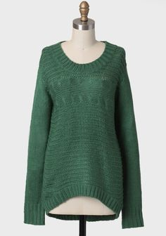 Comfy emerald green knit sweater.  This makes me think of a cozying up to the fire with a good book, listening to the sound of rain.