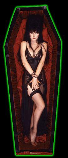 Elvira In Coffin Cardboard Standup Cutout - See and read more about Elvira  http://horrorpedia.com/2014/07/13/cassandra-peterson-aka-elvira-mistress-of-the-dark/