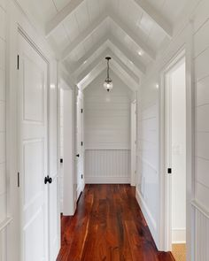 Beautiful hallway with white woodwork. Rustic dark pine floors. Simplicity at its best.