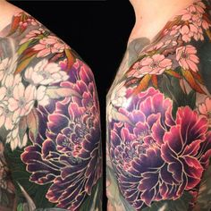 Cool peony tattoo with some cherry blossoms