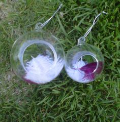Feather in glass balls with one rose