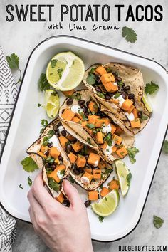 These light and refreshing Sweet Potato Tacos are filled with a simple sweet potato and black bean hash, and topped with a tangy lime crema. BudgetBytes.com