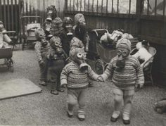 Children at the Broomgrove Children's hotel and nursing home in Wavertree, Liverpool well accustomed to playing in their gas masks. This was my nana's town/life!
