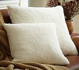 Faux Sheepskin Throw Pillows | Pottery Barn. I have two of these- they are soo soft I <3 them!