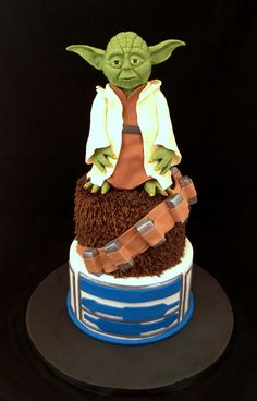 Star Wars cake with sculpted Yoda on top made from modeling chocolate.
