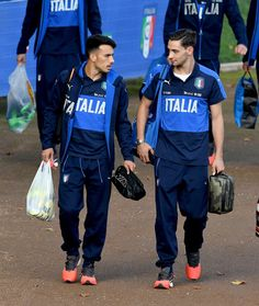 Nicola Sansone (L) and Mattia De Sciglio of Italy chat prior to the training session at the club's training ground at Coverciano on October 3, 2016 in Florence, Italy.