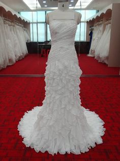 This pretty ruched wedding dress with ruffles could be made in any color.  We can also accommodate all sizes a& measurements. Custom wedding dresses & replicas for the brides on a budget is what we offer.  Get pricing and more details at www.dariuscordell.com