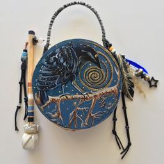 """""""NIGHT TALES"""" ~ $ 124  ~  7inch primitive drum & beater ~ designed & hand-painted by artist:  Sharon Gilbertson  (contact artist on website)  For clothing collection - follow link on website to Sharon's VIDA VOICES shop.  Thank you."""
