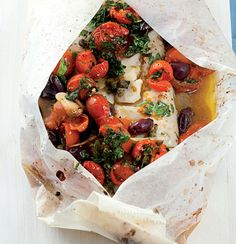 BAKED HAKE PARCELS 800 g hake fillet 200 g smashed ripe cherry tomatoes 12 pitted black olives 2 t capers 2 cloves crushed garlic cup chopped flat-leaf parsley 1 Baked Hake Recipes, Easy Fish Recipes, Seafood Recipes, Cooking Recipes, Healthy Recipes, Hake Recipe Healthy, Light Recipes, Healthy Foods, Yummy Recipes