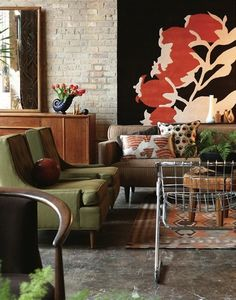 Living Room - Eclectic with bold vibrant palette, large art and vintage furnishings & objects.   Great personal expression of style.
