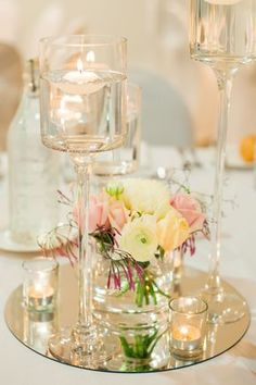 Wedding Table Decorations Mirrors floating candle centerpiece on a round mirror base with fre… – Floating Candles İdeas. Floating Candles Wedding, Floating Candle Centerpieces, Wedding Table Centerpieces, Floral Centerpieces, Floating Flowers, Votive Candles, Candle Rings, Table Wedding, Flower Table Decorations