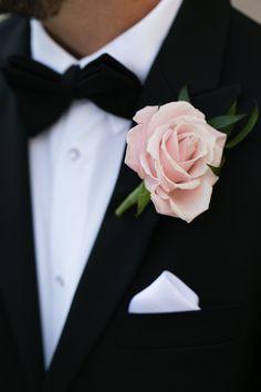 elegant single rose boutonniere