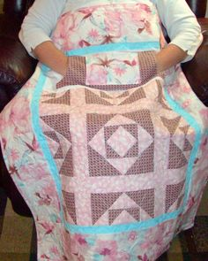 Lovie Lap Quilt with pockets to keep your hands warm. http://www.homesewnbycarolyn.com