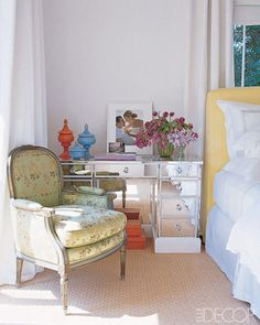 LOVE THIS ROOM  In the master bedroom of Sarah Jessica Parker and Matthew Broderick's weekend house in the Hamptons, a 1940s mirrored desk from Laurin Copen Antiques and a portrait of Parker and Broderick by Pamela Hanson; the vintage armchair upholstered in apple-green Chinese silk is a flea-market find.