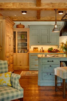 Rustic Kitchen. the mixed wood and painted cabinets are perfect for this kind of setting.