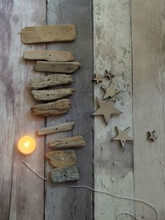 How to make a drift wood and star mobile threading on to twine