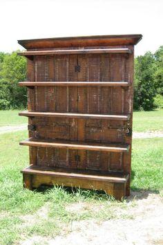 Shelves . 2 salvaged doors . Salvaged boards . Crown Molding . Footing . Repurposed