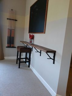 Wooden drink ledge around finished basement