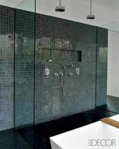 double shower features floors of black slate and a wall covered in glossy marble tiles from Urban Archaeology. The industrial overhead shower fixtures are by Rohl. Bathroom Shower Heads, Shower Tub, Big Shower, Ensuite Bathrooms, Modern Shower, Master Bathroom, Bathroom Images, Bathroom Ideas, Bathroom Remodeling