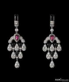 L ' Odysée de Cartier Collection Earrings : In Platinum, featuring two pear-shaped red tourmalines, black onyx and diamonds. | via ctime.com