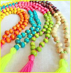 Neon Tassel necklace - neon yellow, neon pink. 4 colour wooden beads with fluro tassel. $25.00, via Etsy.