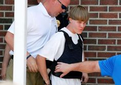 Police lead suspected shooter Dylann Roof, 21, into the courthouse in Shelby, North Carolina, on Jun... - Jason Miczek/Reuters