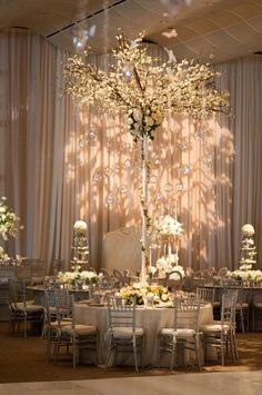 GO featured tabletop: This is pretty much what I want for my future wedding, except I want it to look like a plumeria tree growing out of the table. (And more color, hee hee.)