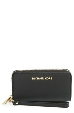 Free shipping and returns on MICHAEL Michael Kors 'Large Jet Set' Saffiano Leather Phone Wristlet at Nordstrom.com. Easily stash your smartphone and other essentials in a sleek zip-around wallet cast in Saffiano leather with an optional wrist strap for on-the-go convenience.