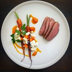 Duck breast • Charred carrots • Chèvre cheese • Sea buckthorn and orange reduction.