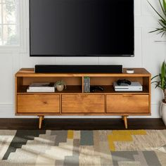 Caramel Mid-Century Modern 58 TV Stand With slightly tapered legs, this TV stand features a mid century modern silhouette to complement your home's aesthetic. Crafted of solid pine wood to showcase a beautiful, natural grain Style At Home, Mid-century Modern, Midcentury Modern Tv Stand, Modern Tv Stands, Modern Ranch, Eclectic Modern, Modern Patio, Vintage Modern, Modern Media Cabinets