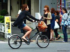 Summer cycling style, Tokyo, Japan.