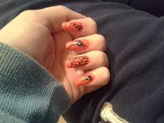 Orange spider nails I did for Halloween. I did the webs using thin brushes and the spiders using migi nail art pens.