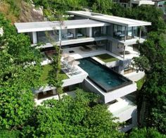 Villa Amanzi, Cantilevered modern architecture in mountains; in Cape Sol, Phuket, Thailand; designed by Original Vision architects; photo by Marc Gerritsen & Helicam Asia Aerial Photography