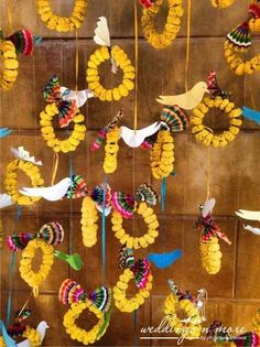 hangings , parrot hangings, genda flower hoops, kitsch decor , photobooth , mehendi photobooth backdrop,
