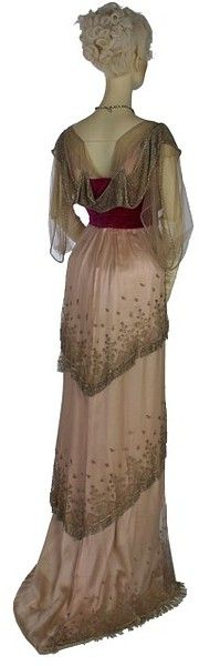 Tiered silk net with metallic embroidery over pink satin with raised-waist velvet bodice. 1910 by the Paris fashion house Worth.