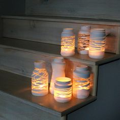 Wrap jars with yarn and spray paint everything white, then remove the yarn.  Easy.