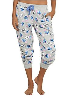 full length - Comfy girls pajama pants from Disney's Lilo & Stitch with allover tossed Stitch heads print design and an elastic drawstring waist.