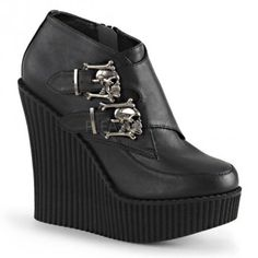 Skull Buckled Wedge Heel Womens Creeper - New at GothicPlus.com Price: $74.95  Womans black vegan leather creeper shoe has double gun metal skull buckles on outside and a vertical ridged 5 1/4 inch heel with a 1 inch wedge. Full inner zipper closure.  Eco-friendly all man made materials with padded insole and non-skid sole.  #gothic #fashion #steampunk