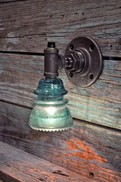 Hey, I found this really awesome Etsy listing at https://www.etsy.com/listing/187307785/glass-insulator-wall-sconce-light-with