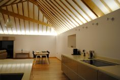 Architecture & Design   Tamsquite use surelight.com LED Flexible strip lights for this hidden cove lighting in this contemporary kitchen in a modern barn conversion