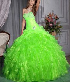 Green poofy dress with bedazzled breast