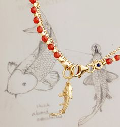 In Japanese culture the koi carp is said to symbolise strength and determination. #jewellery #AstleyClarke #jewelry #gemstone #culture #fish