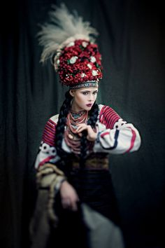 """""""Sincere"""" project. The wedding dress from Bukovina (Chernivtsi region), end of XIX century. Headgear of a bride was made of artificial flowers and decorated with feather grass with long thin hairs. Jewelry - coral and salbі (coins), amount of which showed the wealth of a bride. Dressed: Julia Sanina (singer)"""
