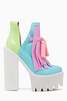 Glow-in-the-dark multicolor pastel mega-platform boot featuring tassel detailing and split ankle.