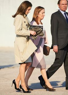 Queen Letizia wore Hugo Boss Cascadia Double Breasted Trench & Hugo Boss Viphima Flared skirt.